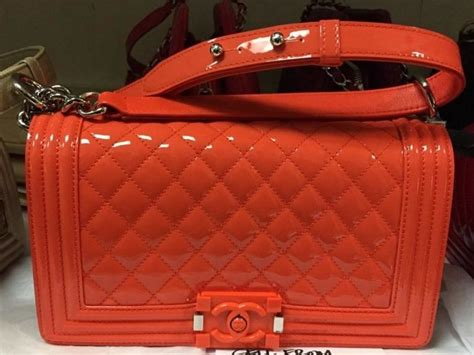 chanel patent boy bag  cruise  features plexiglass closure spotted fashion