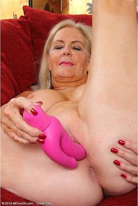 Blonde at the age enjoys pink vibrator