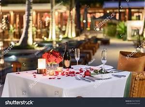 Pool Side Candlelight Dinner Romantic Sunset Stock