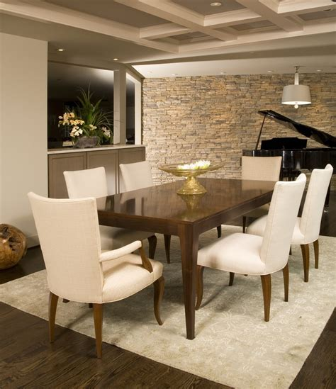 modern dining room  clean lines  neutral stone wall