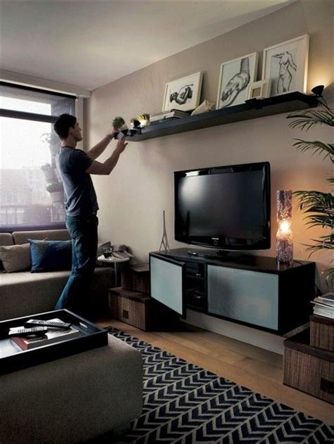 above tv hmmm i d never thought about floating out wall cabinet