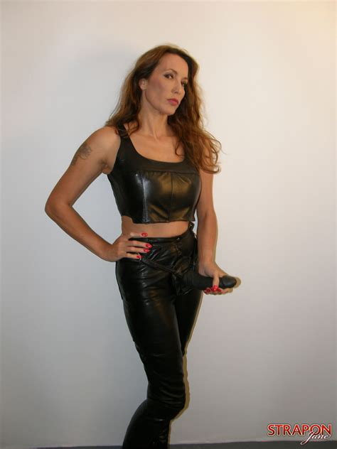 Strapon Jane In A Tight Corset And High Heeled Boots