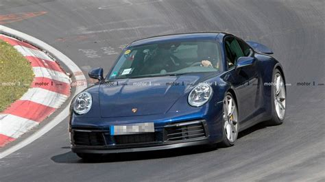 Porsche 911 Photo by New Porsche 911 Spied Winging Its Way Around The Ring