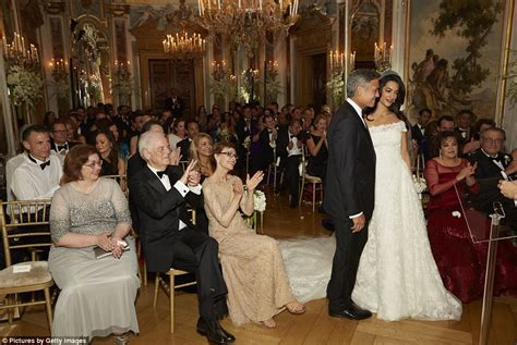 george clooney gazes  wife amal  wedding shots