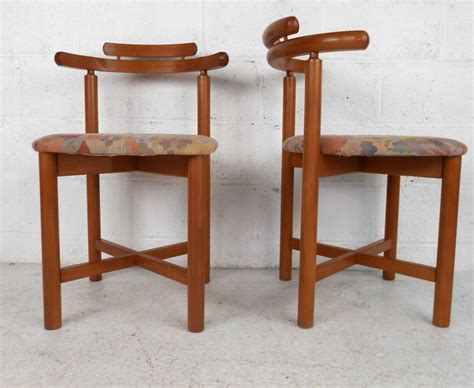 set of mid century modern style teak dining chairs