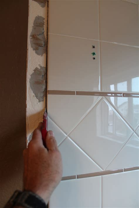 how to remove tiled shower walls