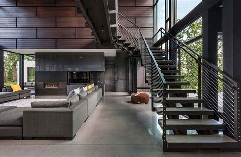 industrial modern house boasts  serene lakeside setting
