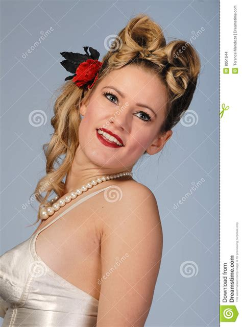 cute fifties girl  victory roll hairstyle stock photo