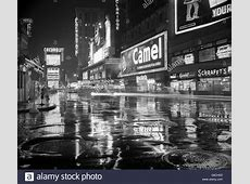 1950s WET RAINY STREETS OF TIMES SQUARE AT NIGHT NEON