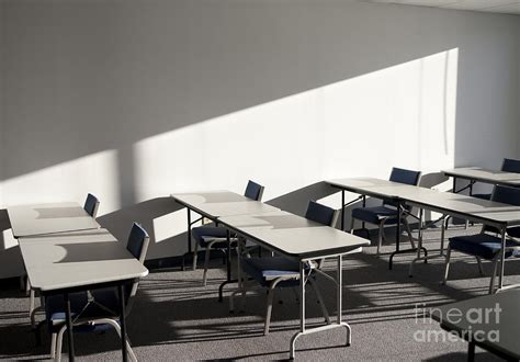 tables and chairs in a college classroom photograph by