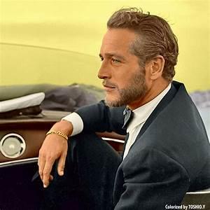 Paul Newman, 1963. Ok, so he is not dark...he has blue ...
