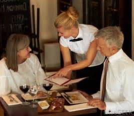 Waiter Serving Customer