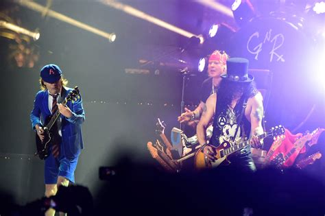 axl rose und ac dc axl rose to replace ac dc s lead singer for postponed tour