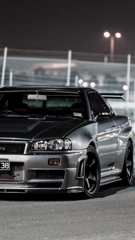 Gtr R34 Wallpaper Iphone by Cars Nissan Skyline R34 Gt R Front Angle View Wallpapers