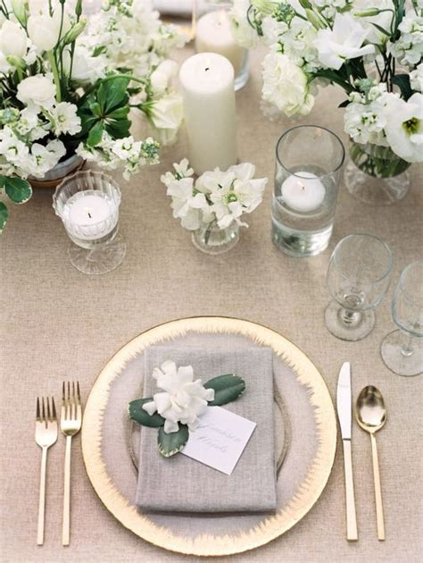 grey white  gold table setting  white florals