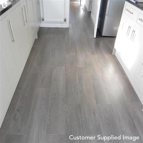 grey wooden flooring winchester grey oak 8mm laminate flooring v groove ac4 2 162m2 from discount flooring depot uk