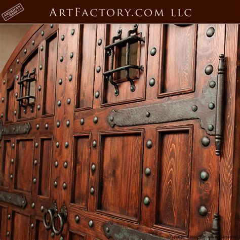 Custom Castle Entrance Doors: Iron Speakeasy Grill & Strap