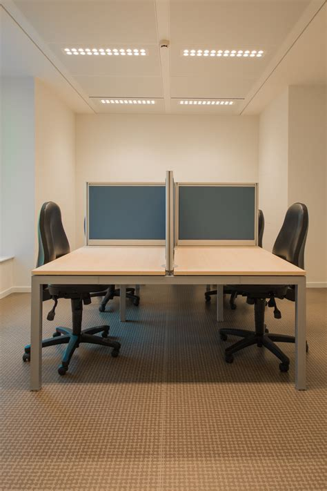 white cubicle  rolling chairs  stock photo