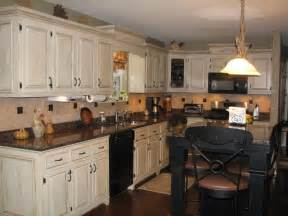 white speckle countertops with black appliances pics of