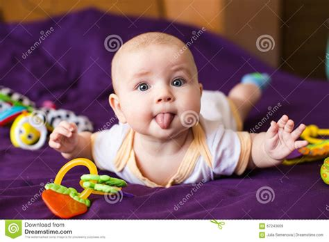Baby Sticking Her Tongue Out Stock Photo Image 67243609