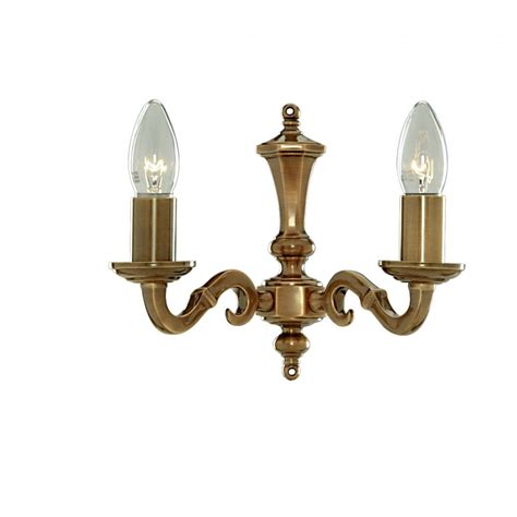 traditional candle style antique brass wall light