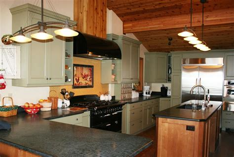 love  green painted cabinets   wood beam