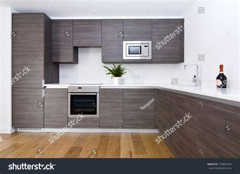 Contemporary Modern Fully Fitted Kitchen Brown Stock Photo