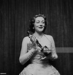 British actress Sarah Churchill poses with an Oscar in Los ...