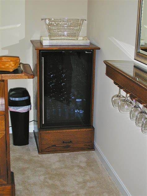 custom built small refrigerator cabinet  stained oak