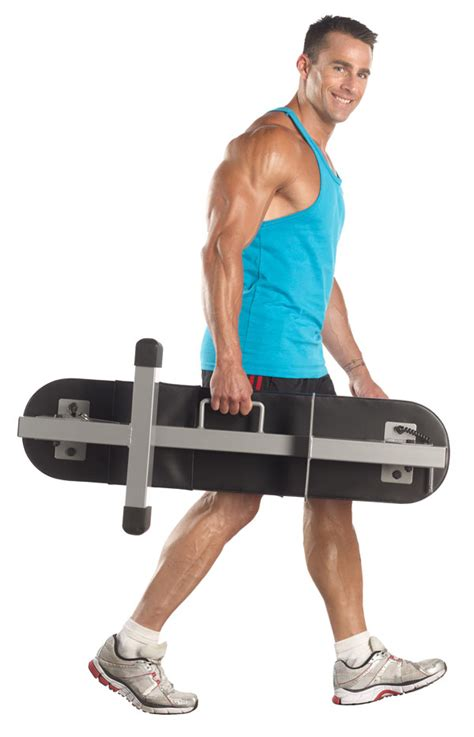 photo banc de musculation pliable sous le lit