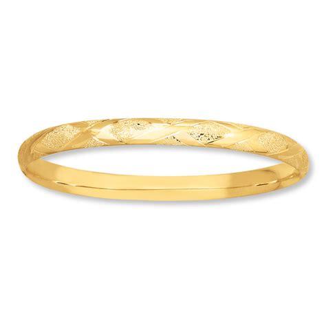 Bangle Bracelet Crisscross Design 14k Yellow Gold. Women's Jewelry. Key Chains. Silk Wrap Bracelet. Gold Band Wedding Ring. Millefiori Pendant. Clear Quartz Necklace. Matching Ankle Bracelets. Different Style Rings