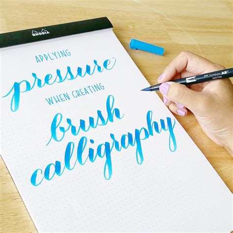 brush pen lettering applying pressure in brush calligraphy with sharisse
