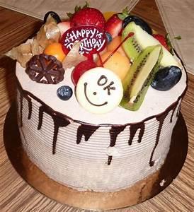 White cream birthday cake with chocolate and fresh fruit.JPG