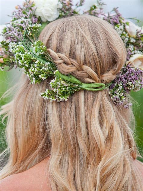 Braided half back hairstyle with a flower crown #
