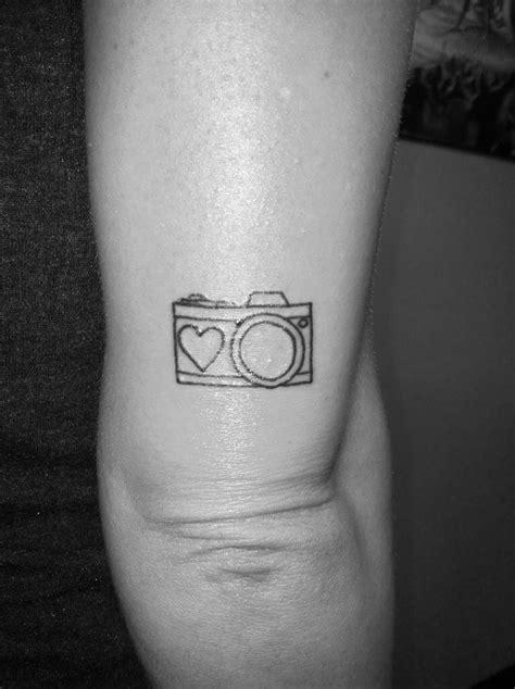 Small camera tattoo above my elbow.   Camera tattoos