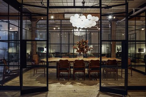 industrial style desk inside east room s hip coworking space in toronto