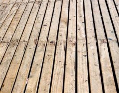 Cleaning Deck With Solution by Wooden Deck Cleaner