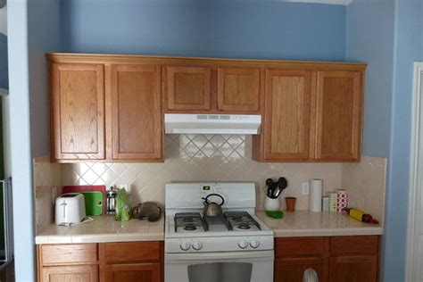 cabinets wood and light blue walls kitchen with