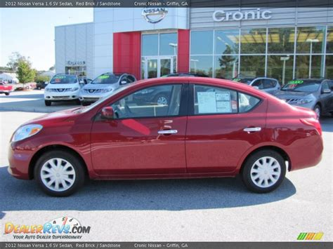 red nissan versa 2012 nissan versa 1 6 sv sedan red brick sandstone photo