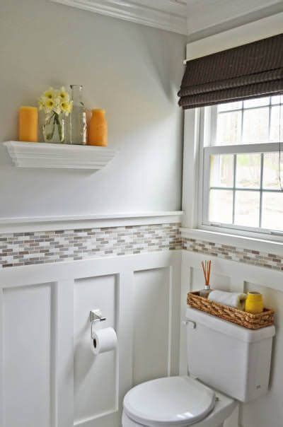 bathroom wainscoting with tile above classic home