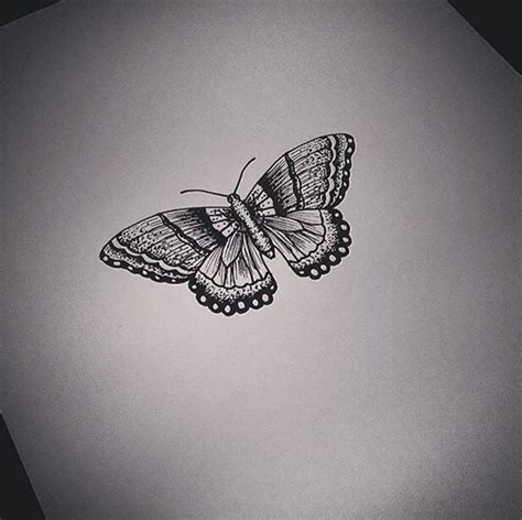 cute small black  white butterfly tattoo design