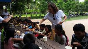 Passing Out Food To The Children In Cambodia
