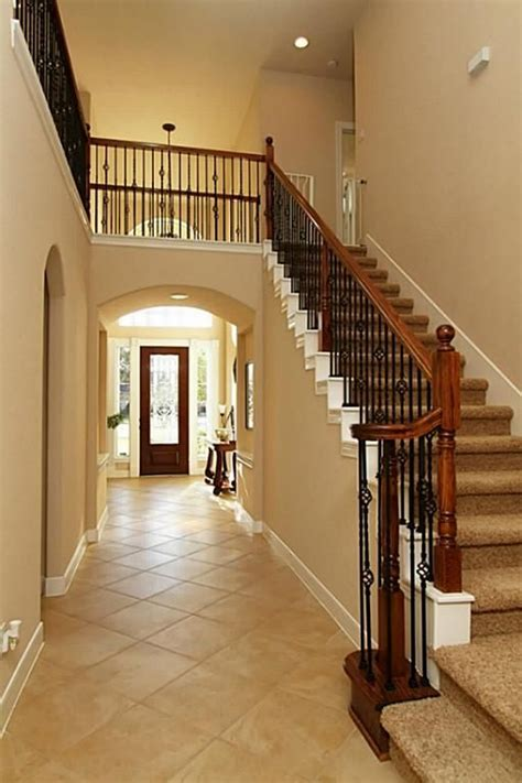 dramatic staircase wwrought iron detail  floor