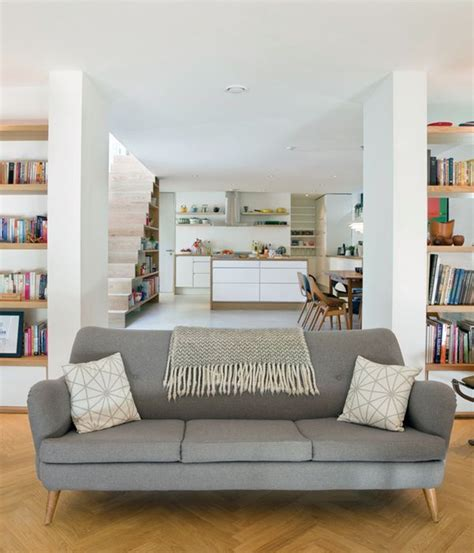Clean Uncluttered Home Scandinavian Influence by 1990s Living Room White Walls Laminate Flooring Fresh