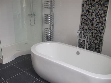 White tiles with button mosaic feature strip