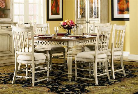 summerglen 7 oval leg dining table with spindle back