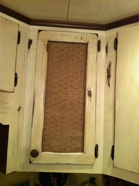 Cabinet with chicken wire and burlap.   design ideas