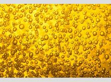 Cold gold beer texture as very nice drink background