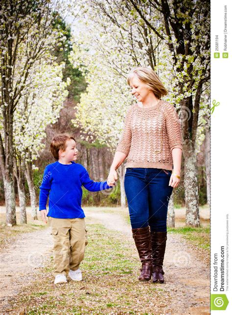 Mother Son Walking Hand Park Stock Photo