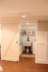 basement renovation traditional laundry room boston With barn door for laundry closet